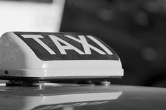 Sign or symbol of a taxi closeup for the car Stock Photography