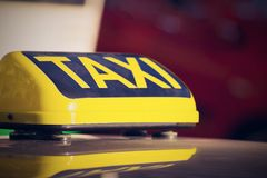 Sign or symbol of a taxi closeup for the car Stock Image