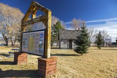 Sign Table and Rustic Log Cabin Mormon Pioneer Heritage Park Panguitch Utah royalty free stock photo