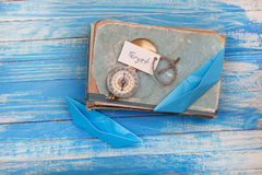 Sign Target and Compass on old book - Vintage style Stock Photography