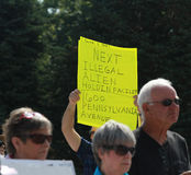 Sign at Tea Party - Illegal Alien Stock Image
