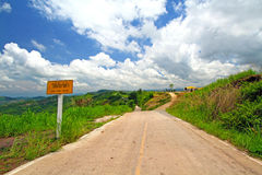 The sign tell tourist the road is slope. And use low gear for driving Royalty Free Stock Photos