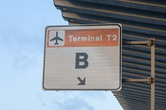 A sign for Terminal T2 B at Barcelona Airport. A weathered sign on a board showing the way to Terminal T2 B in Barcelona, Spain Royalty Free Stock Photography