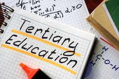 Sign tertiary education written in a notepad. Royalty Free Stock Photo