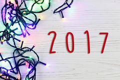 2017 sign text on christmas frame of garland lights. colorful st Royalty Free Stock Photography
