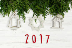2017 sign text on christmas simple toys on green tree branches o. N stylish white rustic wooden background. space for. holiday greeting card concept. unusual Stock Image