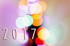 2017 sign text on colorful christmas lights. bright bokeh. magic royalty free stock photos
