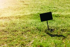 Sign for text on green lawn. copy space, mock up stock photography