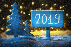 Blue Christmas Tree, Text 2019, Snowflakes, Background With Lights. Sign With Text 2019 For Happy New Year. Blue Christmas Tree With Snow And Magic Glowing stock images