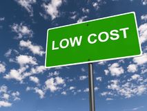 Low cost sign. A sign with the text 'low cost' against the blue sky stock photo