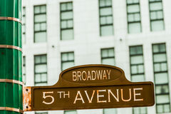 Sign %th. An old rusty 5th avenue and Broadway street sign on a green lampost Stock Photography