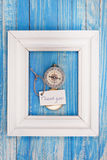 Sign Thank You and Compass in a white frame - Vintage style.  Stock Photography