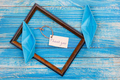 Sign Thank you with photo frame. Vocation background Stock Image