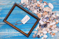 Sign Thank you with shells and photo frame. Vocation background Royalty Free Stock Photography