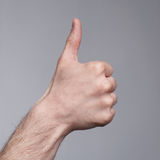 Sign of thumb-up figure Royalty Free Stock Images