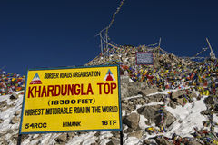 Sign and tibetan prayer flags at Khardung La Pass Ladakh ,India Stock Photos