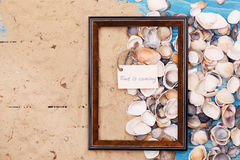 Sign Time is coming with shells and photo frame. Vocation background. Sign Time is coming with sea shells and photo frame. Vocation background Royalty Free Stock Photos
