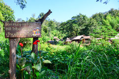 Sign to the Ban Huay Pa Rai Hill Tribe Village. PAI, THAILAND - NOV 23, 2016: Sign welcoming visitors to the Ban Huay Pa Rai Hill Tribe Village long necked Kayan stock photography