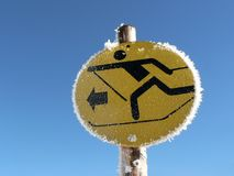 Sign to Crosscountry track. A sign shows the way to the cross-country skiing track Stock Photos