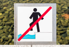 Sign to down into the water is prohibited Royalty Free Stock Photo