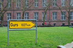 Sign to Gurs (1027 km). A sign in Freiburg, Germany pointing to the Gurs Internment Camp in memorial to the Jews and others send there during the World War II Stock Photography