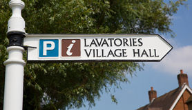 Sign to lavatories and village hall Royalty Free Stock Photos