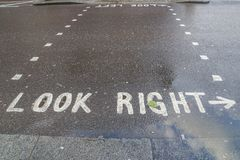 Sign to look right and left on concrete road. Transportation sign to look right and left on concrete road Stock Photos