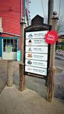 Sign to daily open Yukon Market Hall stock photo