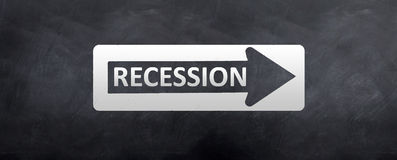 Sign to Recession. A street sign with the words recession written on it royalty free stock photos