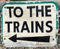 Sign: To the Trains. Old weathered sigh directing the public to the trains Royalty Free Stock Photos