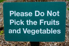 Please dont pick the fruits and vegetables stock image