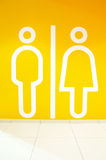 Sign toilet. Symbol of the man and the woman on an orange background Royalty Free Stock Images
