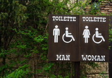 Sign toilette men women and disabled. Panel wood stock illustration