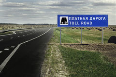 Sign the toll road on the highway Stock Image