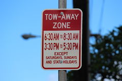 Sign tow-away zone. Tow-away zone sign in the street Stock Photography