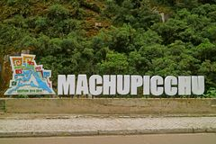 Sign of Town Name at the Roadside of Machupicchu Pueblo or Aguas Calientes, the Gateway to Machu Picchu inca Citadel, Peru. Sign of Town Name at the Roadside of stock photography