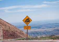 Sign of traffic alerts downhill slope. Sign of traffic alerts downhill slope 10 %, reduce speed and use a lower gear. Drive with caution stock photo