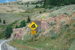 Sign of traffic alerts downhill slope. Sign of traffic alerts downhill slope 10 %, reduce speed and use a lower gear. Drive with caution royalty free stock image
