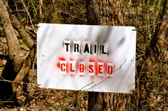 Sign trail closed in woods Stock Photos