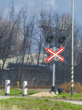 Sign with the train set at the railway crossing Stock Photos