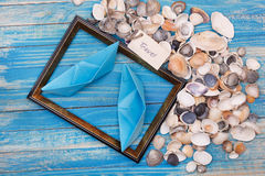 Sign Travel with shells and photo frame. Vocation background Stock Photography