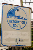 Sign for Tsunami Evacuation Route. Khao Lak, Thailand - August 8, 2013: Sign showing the direction of the Tsunami evacuation route at Khao Lak Royalty Free Stock Image