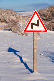 Sign turning road , close-up. Conceptual sign challenges ahead in winter sunny day stock photos