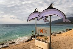 Sign with two dolphins showing the beginning of the nudist beach. FKK is the german abbreviation of naturism stock photo
