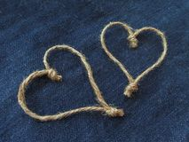 Sign two hearts of twine in denim stock photos
