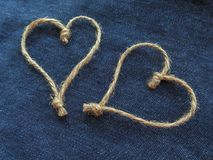 Sign two hearts of twine in denim royalty free stock photography