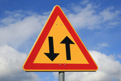 Sign Two Way Traffic Ahead. Sign two way traffic against blue sky with some clouds Stock Images
