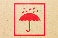 Sign an umbrella on a box Stock Photo