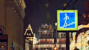 Sign of an underground pedestrian crossing. On a background of snow in the evening Moscow stock video