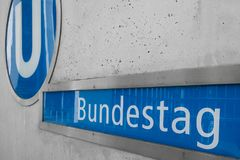 The sign of the underground, subway train station of the Bundestag (house of parliament) in Berlin. Berlin, Germany - october 2017: The sign of the underground stock photos